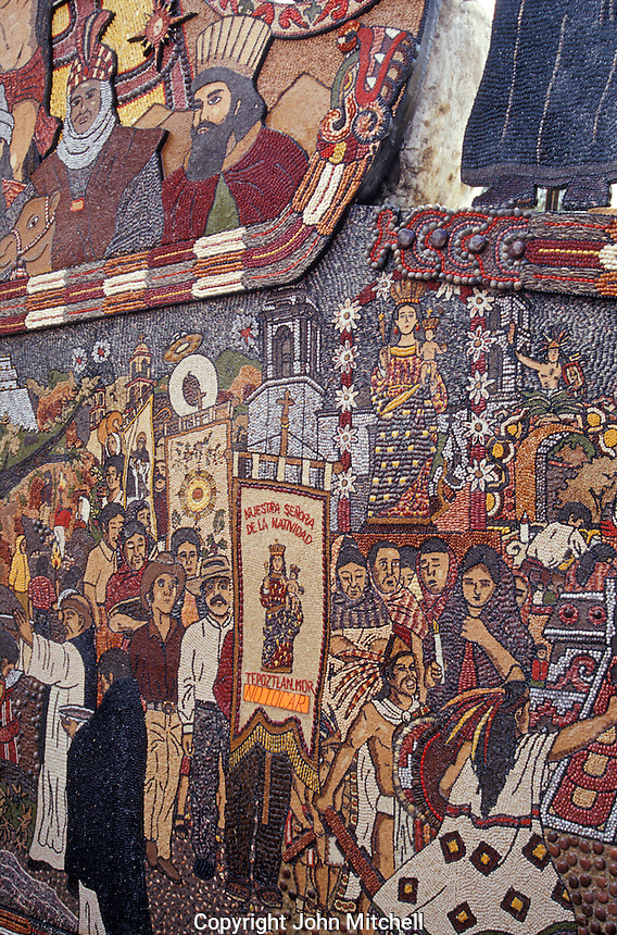 Detail of the seed mural in front of  the Ex-Convento Dominico de la Natavidad in Tepotzlan, Morelos, Mexico. This Dominican monastery was built between 1560 qnd 1588. Its church has a Plateresque facade. The monastery now houses a regional history museum.