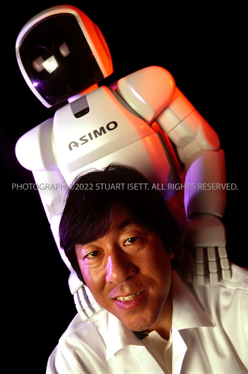 5/28/2001--Tokyo, Japan..Masato Hirose, chief engineer at Honda and head of the company's robot program posing with 'Asimo'....All photographs ©2003 Stuart Isett.All rights reserved.This image may not be reproduced without expressed written permission from Stuart Isett.