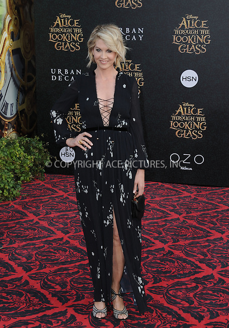 WWW.ACEPIXS.COM<br /> <br /> May 23 2016, LA<br /> <br /> Jenna Elfman arriving at the premiere of Disney's 'Alice Through The Looking Glass' at the El Capitan Theatre on May 23, 2016 in Hollywood, California.<br /> <br /> <br /> By Line: Peter West/ACE Pictures<br /> <br /> <br /> ACE Pictures, Inc.<br /> tel: 646 769 0430<br /> Email: info@acepixs.com<br /> www.acepixs.com