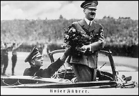 BNPS.co.uk (01202 558833)<br /> Pic: ThomasTWittmann/BNPS<br /> <br /> Erich Kempka (left) with Hitler at Nurnberg in 1938.<br /> <br /> Sinister survivor from the heart of Hitler's Third Reich...<br /> <br /> The SS presentation dagger belonging to Hitler's trusted personal chauffeur - who's final mission was to collect the petrol to burn the Fuhrers body after his suicide at the Reich Chancellery has emerged for sale for £5000.<br /> <br /> SS-Obersturmbannfuhrer Erich Kempka fulfilled the key security role in the Fuhrer's entourage from 1936 until his death on April 30, 1945.<br /> <br /> The sinister 13ins dagger is engraved with Kempka's initials 'EK', along with the elite SS mark and the Nazi eagle adorning the handle.