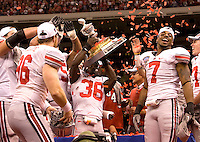 Ohio State football players celebrate with Sugar Bowl Champion trophy after defending Arkansas during 77th Annual Allstate Sugar Bowl Classic at Louisiana Superdome in New Orleans, Louisiana on January 4th, 2011.  Ohio State defeated Arkansas, 31-26.
