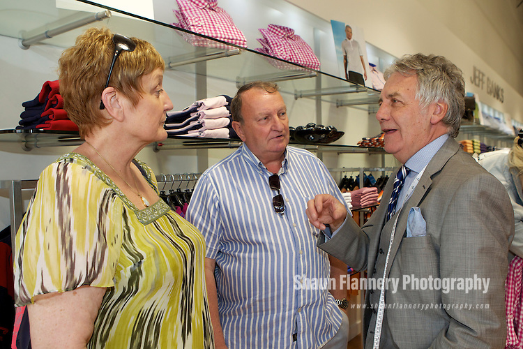 Pix: Shaun Flannery/shaunflanneryphotography.com...COPYRIGHT PICTURE>>SHAUN FLANNERY>01302-570814>>07778315553>>..9th April 2011...............Lakeside Village, Doncaster..Designer Jeff Banks visits the Jeff Banks store at the outlet..Customer's Adrian & Heather Norgrove.