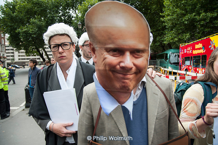 Mock trial of Justice Minister Chris Grayling.  UK Uncut ad Disabled People Against the Cuts block the road outside the Royal Courts of Justice in protest at proposed cuts to Legal Aid.