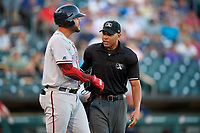 Umpire Jeremie Rehak stands in between Syracuse Chiefs designated hitter Chris Dominguez (17) and pitcher Sean Reid-Foley (not shown) after Dominguez was hit by a pitch in the head during a game against the Buffalo Bisons on July 6, 2018 at Coca-Cola Field in Buffalo, New York.  Buffalo defeated Syracuse 6-4.  (Mike Janes/Four Seam Images)