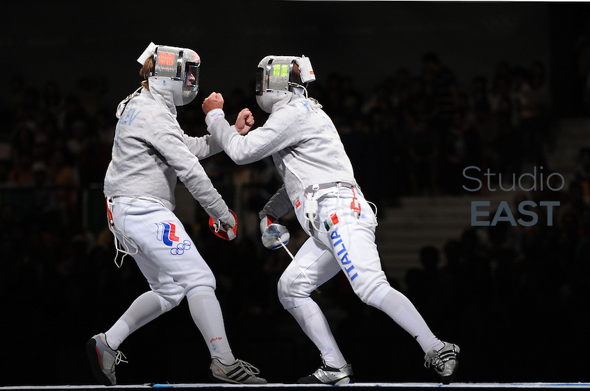 Nikolay Kovalev (L) of Russia and Giampiero Pastore of Italy (R) raise the fist while competing in the men's team sabre fencing bronze medal match at the Fencing Hall of National Convention Center on Day 9 of the Beijing 2008 Olympic Games on August 17, 2008 in Beijing, China. Photo by Lucas Schifres/Pictobank/Cameleon/ABACAPRESS.COM