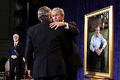 Washington, DC - December 19, 2008 -- United States President George W. Bush, right, shakes hands with artist Robert Anderson while G. Wayne Clough. Secretary of Smithsonian looks on after the unveiling of his portrait at the National Portrait Gallery in Washington, D.C. on Friday, December 19, 2008.  .Credit: Ken Cedeno / Pool via CNP
