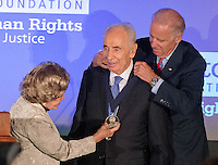 United States Vice President Joe Biden presents President Shimon Peres of Israel the Lantos Human Rights Prize bestowed by the Lantos Foundation for Human Rights in honor of the late Congressman Tom Lantos (Democrat of California).  Annette Lantos, wife of the late Congressman is at left.<br /> Credit: Ron Sachs / CNP /MediaPunch