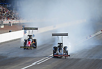 Mar. 31, 2012; Las Vegas, NV, USA: NHRA top fuel dragster driver Doug Kalitta gets forced toward the centerline by the wind during qualifying for the Summitracing.com Nationals at The Strip in Las Vegas. Mandatory Credit: Mark J. Rebilas-