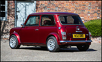 BNPS.co.uk (01202 558833)<br /> Pic: Silverstone/BNPS<br /> <br /> A 'funky' Mini Cooper that comes complete with its own disco ball and drinks bar is to be sold at auction by Jamiroquai singer Jay Kay.<br /> <br /> Affectionately nicknamed 'Chuckles' by the star, the Cooper Sport has been given a complete overhaul and is now completely unique.<br /> <br /> It has been fitted with plush velvet curtains and a bespoke red leather interior to go with a multicoloured disco light located on the cabin ceiling.
