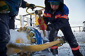 Russian workers at Achimgaz's UKPG gas and condensate processing system in Novy Urengoi, Arctic Siberia, Russia. Achimgaz is a joint-venture between Germany's BASF Wintershall and Russia's Gazprom. Photo by photographer Justin Jin.