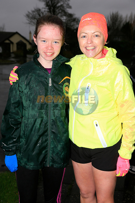 Ciara Reilly and Audrey Hannon at the Goal Mile run in St Fechins GAA Club.<br /> Picture www.newsfile.ie