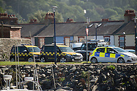 Aberystwyth Wales UK  Wednesday 31 August 2016<br /> Pictured: RNLI, Coastguard and police wait at the coast.<br /> Re: Re: A man tried to save his friend who died after falling out of a speedboat, an inquest has been told.<br /> William George Davies, 63, from Borth, died in August after he was thrown overboard during a fishing trip off Aberystwyth.<br /> A second man, Alan Jones, was also thrown overboard but survived.<br /> The inquest at Aberystwyth Justice Centre was told the cause of death was drowning and coroner Peter Brunton recorded a conclusion of misadventure.<br /> Mr Brunton said he had &quot;concerns&quot; over the fact the two men were not wearing life jackets, the sea had been &quot;choppy&quot; and Mr Jones had taken off the kill cord which would automatically stop the engine if he were thrown overboard.<br /> The inquest heard the men had set out at about 7.30am on 31 August to go fishing, but headed to Aberystwyth harbour a short time later when Mr Davies started to feel unwell - which his friend put down to sea sickness.