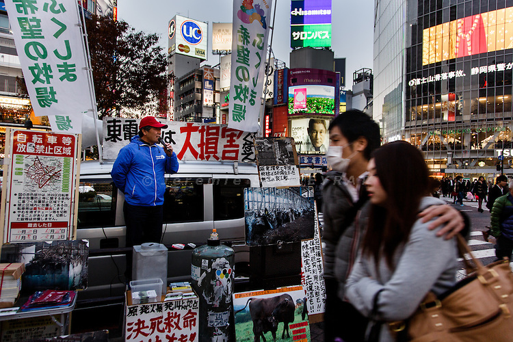 Tokyo, December 2 2013 - At the famous crossing of Shibuya station, the farmer from Namie Masami Yoshizawa protest against TEPCO and the government.