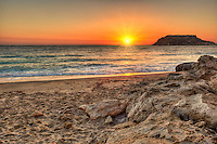 The sunset in Fragolimnionas beach of Karpathos, Greece