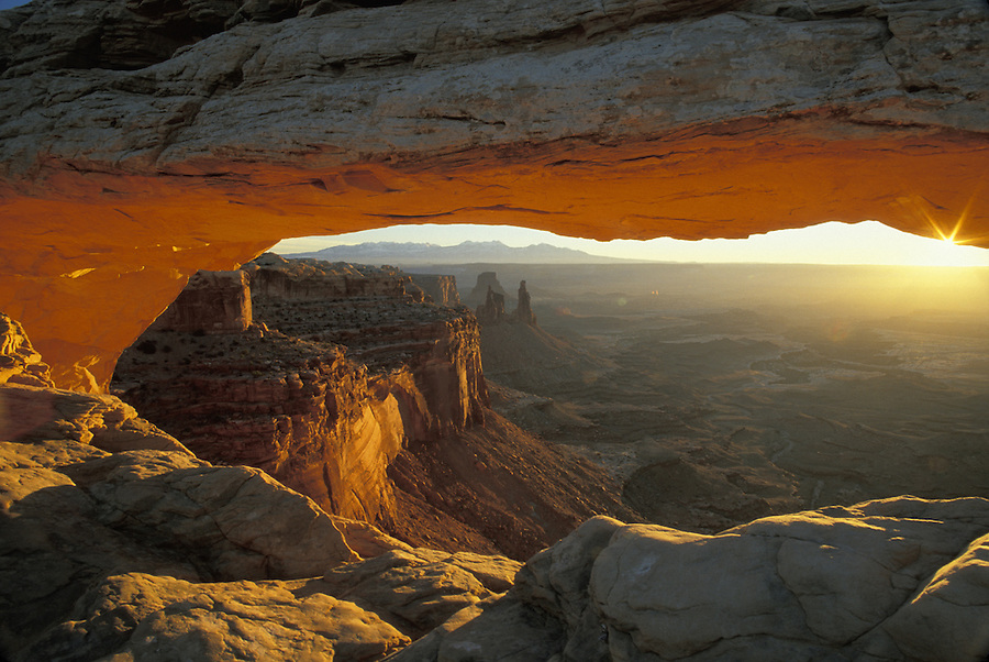 Sunrise light reflecting on Mesa Arch, Island in the Sky District, Canyonlands National Park, Utah.