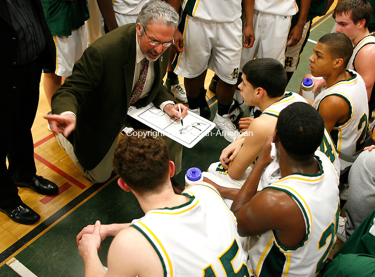 Holy Cross coach Ed Generali creates a defensive plan during a time out with his team in Division LL second round action at Holy Cross High School Wednesday night.  The Crusaders were defeated by the Hornets 58-59  Michael Kabelka Republican / American.