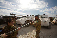 Italian soldiers from  first Platoon, Montebello Squadron, Fifth  Lancieri of Novara regiment of the Italian Cavalry clean the main gun of a centauro armored vehicle during a routine maintenance at  the UNIFIL Chama base in Southern Lebanon on Saturday Dec 09 2006..Close to 1000 Italian peacekeepers operate in  the in Southern lebanon town of Chama, constantly patrolling their sector in search for illegal weapons in the country.