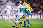 Marco Asensio Willemsen of Real Madrid (L) fights for the ball with Jose Vicente Gomez Umpierrez of UD Las Palmas (R) during the La Liga 2017-18 match between Real Madrid and UD Las Palmas at Estadio Santiago Bernabeu on November 05 2017 in Madrid, Spain. Photo by Diego Gonzalez / Power Sport Images
