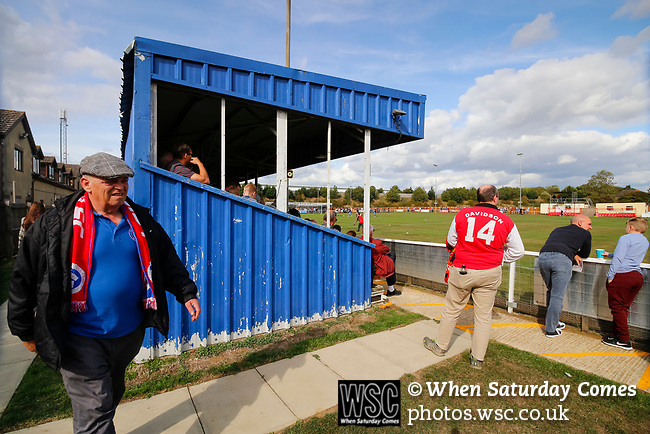 A Kettering fan wearing a retro 1970s shirt. Kettering Town 1 Leiston 2, Evo Stick Southern League Premier Central, Latimer Park. Kettering Town are a famous name in non-league football. After financial problems, relegations, and relocation, the club are once again upwardly mobile. Despite losing to Leiston, Kettering finished the season as Champions and were promoted to the National League North.