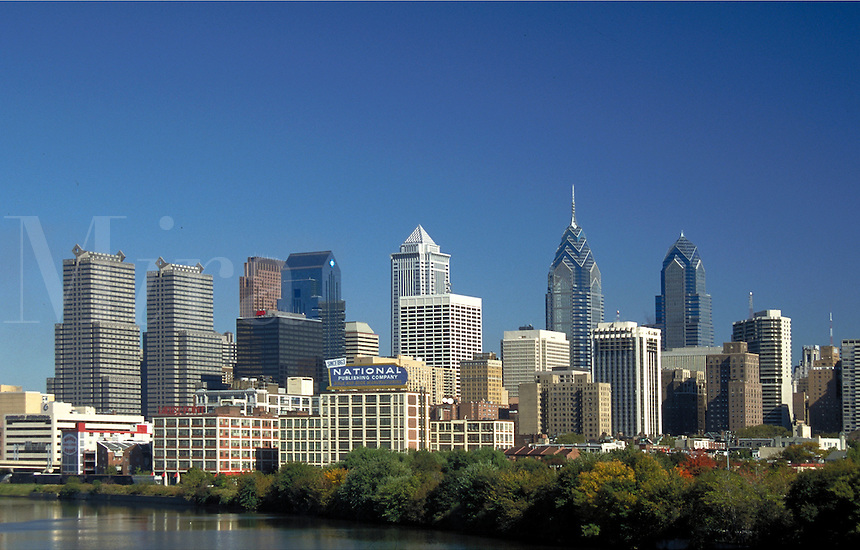 Daytime, blue sky, skyline of Philadelphia is viewed from the west across the Schuylkill River. Philadelphia Pennsylvania United States.