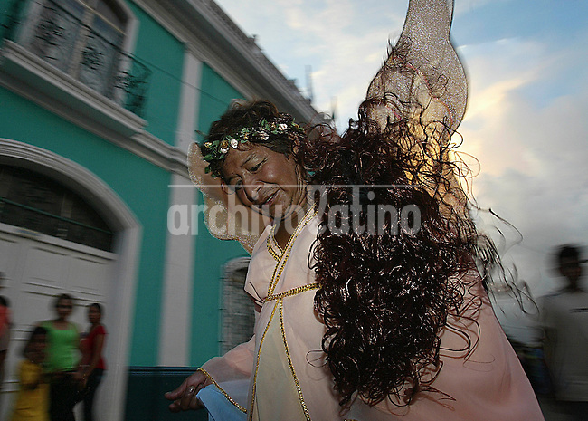 A woman  in the street parade of Carnival in Masaya.,