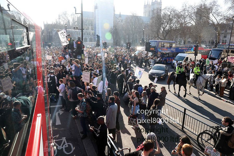 """Pic shows: Student climate change demo got angry stopping traffic for hours <br /> <br /> Many were climbing things and shouting """"fuck Theresa May""""<br /> <br /> Socialist workers were recruiting beneath the statue of Churchill that had been climbed by kids with placards<br /> <br /> <br /> <br /> <br /> pic by Gavin Rodgers/Pixel8000"""