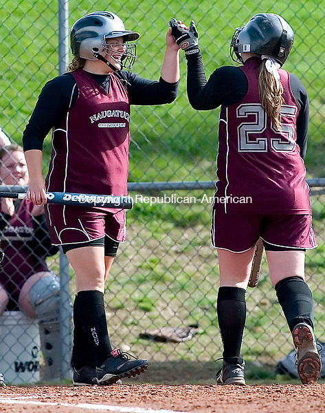 WOLCOTT, CT- 21 MAY 2008- 052108JT04-<br /> Naugatuck's Melissa Salamon, left, high-fives Necole Morrissey after the team's fourth run was scored during Wednesday's NVL tournament semifinal game against Woodland at Wolcott. Visit www.rep-am.com to view a photo gallery of the event.<br /> Josalee Thrift / Republican-American