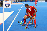 China's Lu Fenghui holds the ball up at the corner flag during the Hockey World League Semi-Final Pool A match between China and Korea at the Olympic Park, London, England on 17 June 2017. Photo by Steve McCarthy.