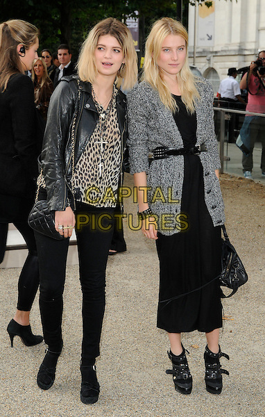 PIXIE GELDOF & GUEST .attending the Burberry Prorsum Spring Summer Collection, during London Fashion Week at the Chelsea College of Art and Design, London, England, UK, September 21st 2010. .LFW show full length black biker leather jacket animal leopard print top jeans sandals socks open toe bag chanel .CAP/CAN.©Can Nguyen/Capital Pictures.