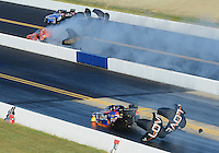 Apr. 13, 2012; Concord, NC, USA: NHRA funny car driver Tony Pedregon (bottom) has a fire during qualifying for the Four Wide Nationals at zMax Dragway. Mandatory Credit: Mark J. Rebilas-