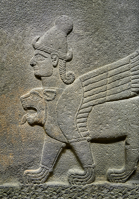 Hittite relief sculpted orthostat stone panel of Herald's Wall Basalt, Karkamıs, (Kargamıs), Carchemish (Karkemish), 900-700 B.C. Chimera. Anatolian Civilisations Museum, Ankara, Turkey.<br /> <br /> Three-headed sphinxes. Winged lion, with a bird of prey's head on the end of its tail, also has a human head with hair in plaits and a conical headdress. The details in his feet are very distinct.