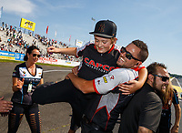Jun 11, 2017; Englishtown , NJ, USA; Gary Pritchett, crew member for NHRA top fuel driver Steve Torrence celebrates with teammates after winning the Summernationals at Old Bridge Township Raceway Park. Mandatory Credit: Mark J. Rebilas-USA TODAY Sports