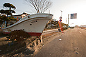 Mar. 13, 2011 - Ibaraki, Japan - A boat is shown piled up on the street in Oarai two days after the 8.9 magnitude earthquake struck followed by a tsunami that hit the north-eastern region. The death toll is currently unknown with casualties that may run well into the thousands.