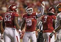 Hawgs Illustrated/BEN GOFF <br /> Randy Ramsey (10), Arkansas linebacker, congratulates defensive lineman McTelvin Agim (3) after a stop in the second quarter against Florida A&M Thursday, Aug. 31, 2017, during the game at War Memorial Stadium in Little Rock.