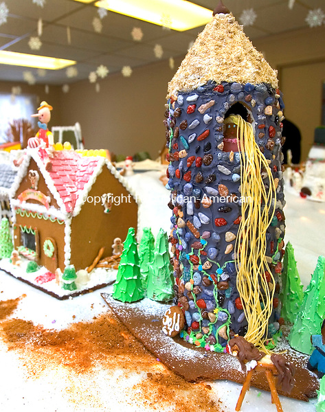 For Country Life Use Only<br /> MIDDLEBURY, CT. 06 December 2010-120610SV07--Rapunzel sits at the top of this gingerbread tower at the St. George's Church annual Gingerbread Village fundraiser in Middlebury Monday.<br /> Steven Valenti Republican-American