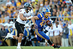 BROOKINGS, SD - SEPTEMBER 12:  Brady Mengarelli #44 from South Dakota State scampers past Chance Beamson #98 from Southern Utah in the first half of their game Saturday night in Brookings. (Photo by Dave Eggen/Inertia)