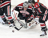 Chloe Desjardins (NU - 29), Melissa Haganey (NU - 19) - The Boston College Eagles defeated the Northeastern University Huskies 3-0 on Tuesday, February 11, 2014, to win the 2014 Beanpot championship at Kelley Rink in Conte Forum in Chestnut Hill, Massachusetts.