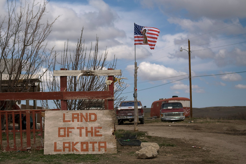 Land of the Lakota - handmade sign in front of a house in Pine Ridge, Pine Ridge Reservation.