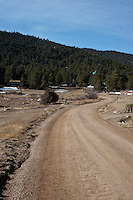 Pinewood Drive near the border between Pinewoods Springs and the Arapahoe-Roosevelt National Forest in Pinewood Springs, Colorado, Wednesday, February 1, 2012. National Forests in Colorado could, under rule making now going on in the Obama administration, have much reduced protections from development than the rest of the nation under the so-called roadless rules, proposed in the Clinton administration, and recently vindicated by a federal appeals panel...Photo by Matt Nager