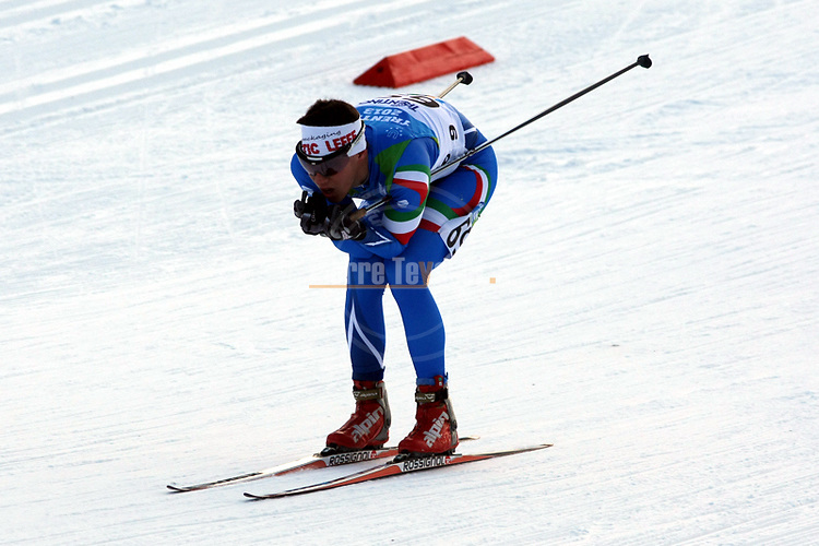 Athlete competes at the Men Skiathlon event as part of the Trentino 2013 Winter Universiade Italy on 12/12/2013 in Lago Di Tesero, Italy.<br /> <br /> &copy; Pierre Teyssot - www.pierreteyssot.com