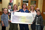 Catriona Seery and her children, Moya and Leon with Shona Behan and her children, Conor and Ciarán presenting cheque to Christina Byrne of The Special Baby Care Unit in Our Lady of Lourdes Hospital, Drogheda...Photo NEWSFILE/Jenny Matthews.(Photo credit should read Jenny Matthews/NEWSFILE)....This Picture has been sent you under the condtions enclosed by:.Newsfile Ltd..The Studio,.Millmount Abbey,.Drogheda,.Co Meath..Ireland..Tel: +353(0)41-9871240.Fax: +353(0)41-9871260.GSM: +353(0)86-2500958.email: pictures@newsfile.ie.www.newsfile.ie.FTP: 193.120.102.198.