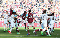 James Collins of West Ham United wins the aerial ball during a Swansea corner late in the game during the Premier League match between West Ham United and Swansea City at the London Stadium, England, UK. 08 April 2017