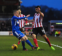 Lincoln City's Jordan Williams is fouled by Notts County's Terry Hawkridge<br /> <br /> Photographer Chris Vaughan/CameraSport<br /> <br /> The EFL Sky Bet League Two - Lincoln City v Notts County - Saturday 13th January 2018 - Sincil Bank - Lincoln<br /> <br /> World Copyright &copy; 2018 CameraSport. All rights reserved. 43 Linden Ave. Countesthorpe. Leicester. England. LE8 5PG - Tel: +44 (0) 116 277 4147 - admin@camerasport.com - www.camerasport.com