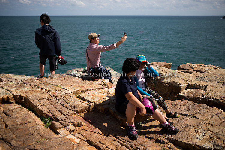 9/6/2013--Busan, South Korea<br /> <br /> Visitors enjoy the Taejongdae Cliffs in Busan (Pusan).<br /> <br /> Photograph by Stuart Isett<br /> &copy;2013 Stuart Isett. All rights reserved.