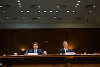 """Mark W. Begor, Chief Executive Officer, Equifax, Inc., left, and Arne M. Sorenson, President and Chief Executive Officer, Marriott International, Inc., right, testify before the United States Senate Committee on Homeland Security and Governmental Affairs Permanent Subcommittee on Investigations during a hearing on """"Examining Private Sector Data Breaches"""" on Capitol Hill in Washington, DC on Thursday, March 7, 2019.<br /> Credit: Ron Sachs / CNP/AdMedia"""