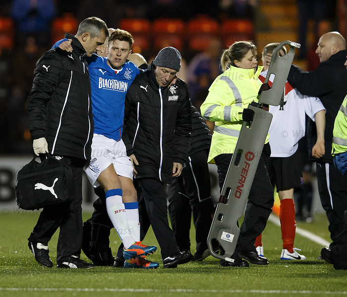 Lewis Macleod carried off injured by the Rangers medical staff