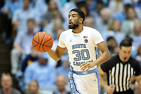 CHAPEL HILL, NC - JANUARY 4: K.J. Smith #30 of the University of North Carolina brings the ball up the court during a game between Georgia Tech and North Carolina at Dean E. Smith Center on January 4, 2020 in Chapel Hill, North Carolina.