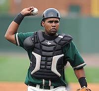 Catcher Wilfredo Gimenez (25) of the Greensboro Grasshoppers, Class A affiliate of the Florida Marlins, in a game against the Greenville Drive on April 25, 2011, at Fluor Field at the West End in Greenville, S.C. Photo by Tom Priddy / Four Seam Images