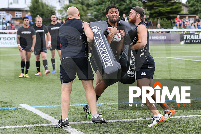 London Broncos players warm up ahead of the Kingstone Press Championship match between London Broncos and Featherstone Rovers at Castle Bar , West Ealing , England  on 25 June 2017. Photo by David Horn.