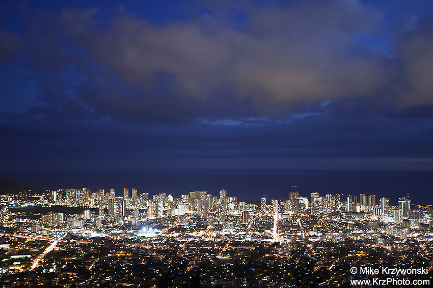 View of Honolulu city lights at night from the Tantalus Overlook, O'ahu
